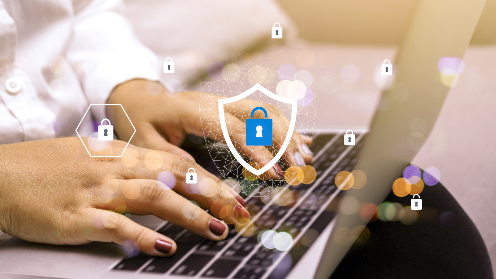 persons hands typing on keyboard with security lock graphics superimposed on image