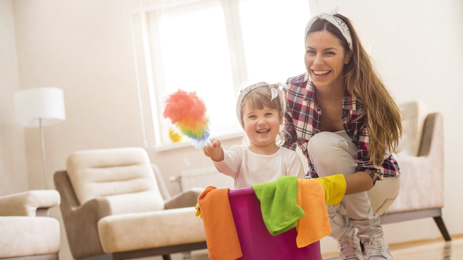 Mother and young daughter cleaning together